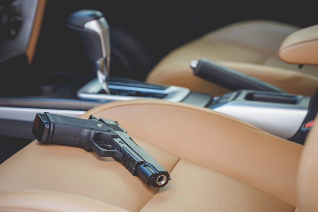 pistol in plain view on car seat