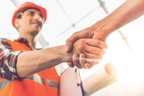 contractor shaking hands - Business & Professions Code 7028.1 BPC makes it illegal for even a licensed contractor to perform asbestos work without certification