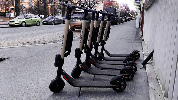 Row of e-scooters - people injured on or by a Bird Scooter can bring a lawsuit seeking damages