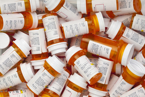 pile of prescription bottles - the excessive prescribing of drugs is a crime in California
