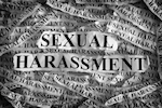 Sexual harassment written on newspaper print