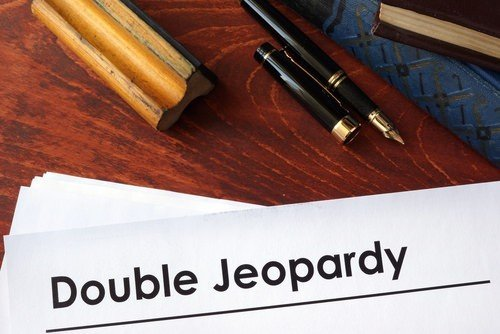 Is it double jeopardy to charge someone in state and federal court?