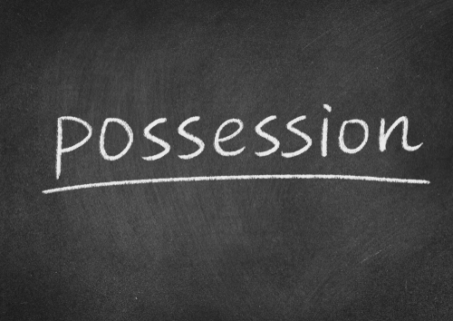 """chalkboard with the word """"possession"""" - NRS 200.730 makes it a crime to possess child pornography in Nevada"""