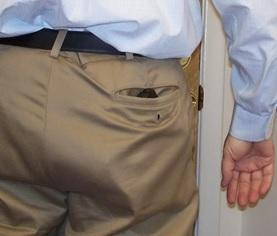 Concealed gun in man's back pocket