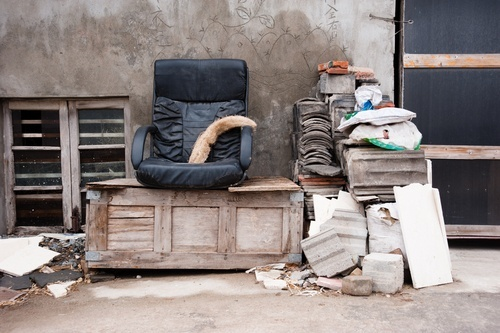 Junk piled up outside a person's home as an example of a private nuisance in California