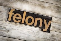 "sign that reads ""felony"""