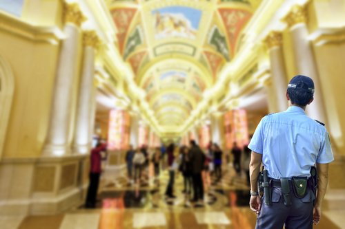 Security guard and crowds at Las Vegas hotel shopping mall