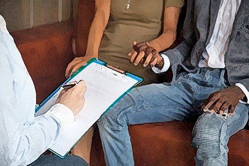couple in therapy holding hands - the spousal privilege in California protects spouses from disclosure of confidential communications