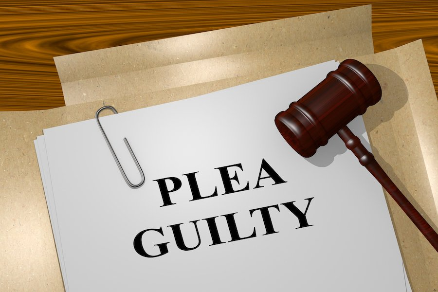 Gavel and paper that says plea guilty