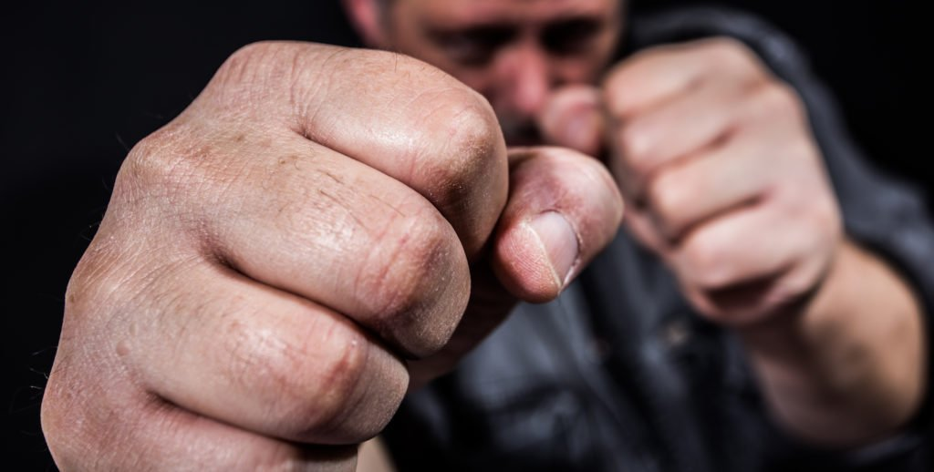 Closeup of fists in ready position to punch
