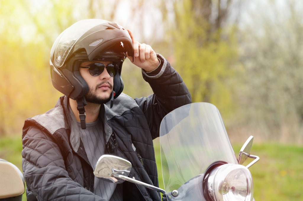 Motorcyclist with helmet in accordance with NRS 486.321