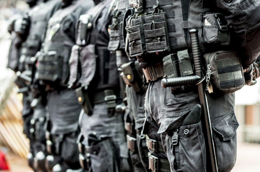 Line of police in anti-terrorist gear