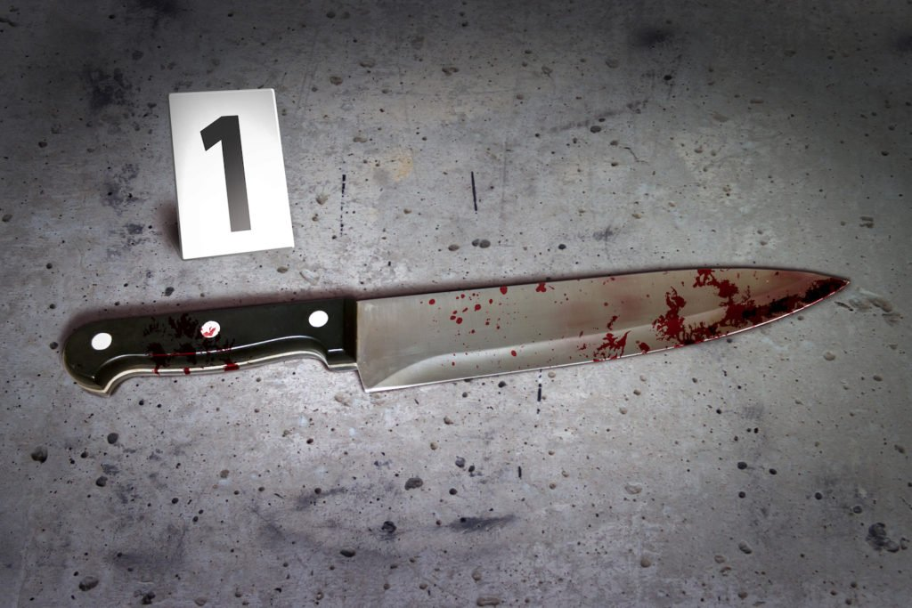 Bloody knife with evidence tag saying number 1