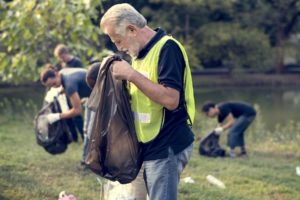 Man gathering trash from field