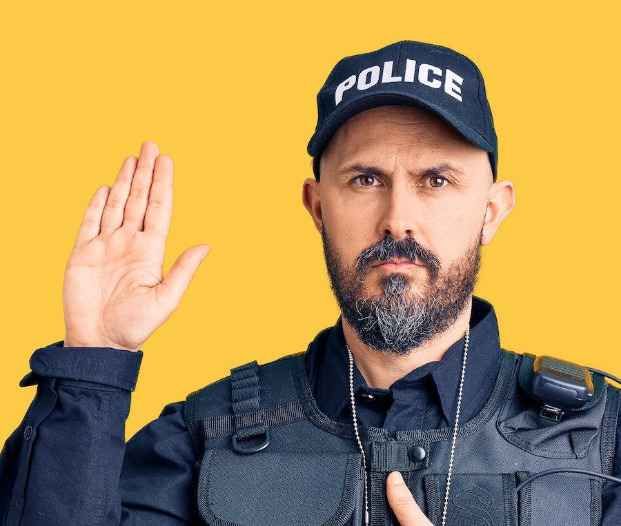 Policeman taking an oath during - officers frequently testify at DMV hearings in Colorado DUI cases