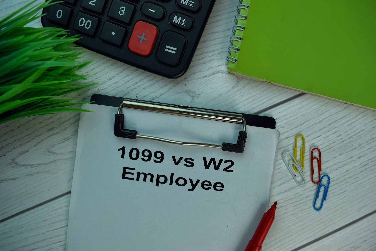 Paper that says 1099 v. W2 employee