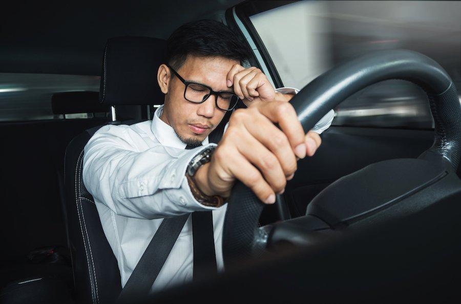 Man sleeping behind the wheel