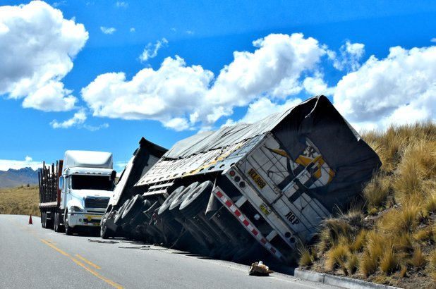 An 18 wheeler overturned on the highway.